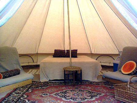 Interior of a Bell tent at Woodland Escape Glamping Holidays in Somerset
